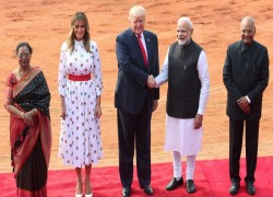 AFTER RAUCOUS WELCOME IN INDIA, TRUMP SET FOR TALKS ON TRADE, ARMS DEALS