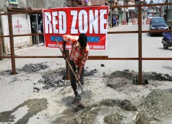 Covid-19 'red zones' are sealed with iron barricades in Kashmir