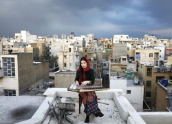 Amid lockdown Iran, isolated musicians perform from rooftops