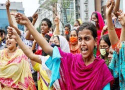 BD textile workers flout coronavirus lockdown to demand wages