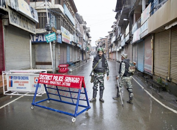 How is India altering demographic dynamics in Kashmir?