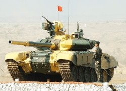 Singh talks tough as India moves tanks near border