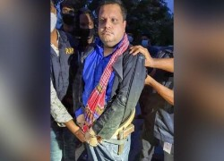 SHAHED WAS HIDING IN A SEWERAGE DRAIN WEARING BURQA WHILE ARRESTED