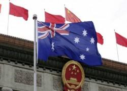AUSTRALIAN JOURNALISTS FLEE CHINA FEARING ARREST