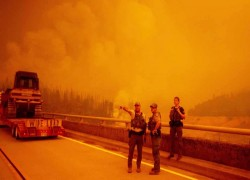 Winds fuel wildfires across US west, destroying record 2.5m acres
