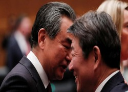 China to gauge Suga's stance with Wang Yi visit to Japan