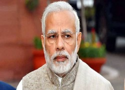 WORKING ON COVID-19 VACCINE DELIVERY SYSTEM: PM MODI