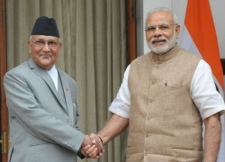NEPAL SIGNALS TIES WITH INDIA ARE WARMING UP BUT CHINA KEEPS THEM ON THE EDGE