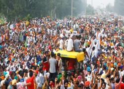 PROTESTING INDIAN FARMERS LOCKED IN STAND-OFF WITH POLICE NEAR CAPITAL