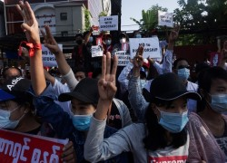 Myanmar protests: Woman shot in head as police response escalates