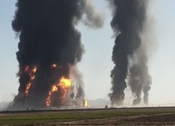 INFERNO ON AFGHANISTAN-IRAN BORDER AS DOZENS OF OIL TANKERS CATCH FIRE