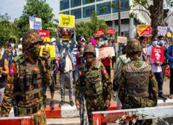 Myanmar protesters urge central bankers to boycott junta
