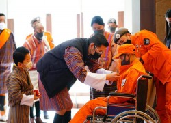 King of Bhutan personally presents service honour to volunteer
