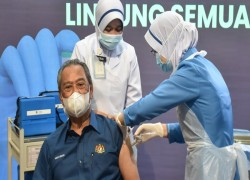 Malaysia starts COVID vaccines in crucial week for Asian jabs