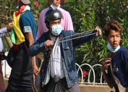 Myanmar military supporters attack anti-coup protesters