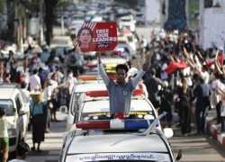 Myanmar police raid protest district as World Bank halts some payments