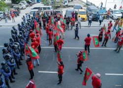 Opposition takes to the streets despite police warning