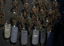 MYANMAR POLICE FIRE STUN GRENADES AS SOUTHEAST ASIAN MINISTERS AIM FOR TALKS