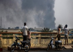 Myanmar factory attacks drag China into crisis