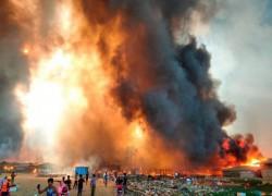 TENS OF THOUSANDS FLEE HUGE BLAZE IN ROHINGYA CAMP IN BANGLADESH