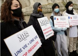 'Law against Islam': French vote in favour of hijab ban condemned