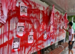 'Bloody paint strike' in Myanmar as doctors charged over protests