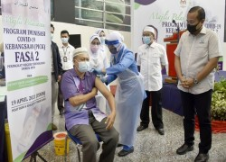 Malaysia starts second phase of Covid-19 vaccinations amid concerns over inoculation rate