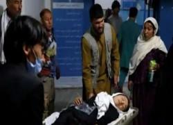 At least 68 killed in Afghan school blast, families bury victims