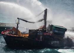 Sri Lanka grills crew of burning cargo ship as it assesses ecological damage