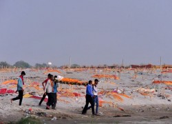 Poverty, stigma behind bodies floating in India's Ganges River