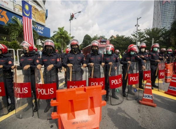 Opposition MPs renew calls for Malaysia's PM to resign at protest outside Parliament