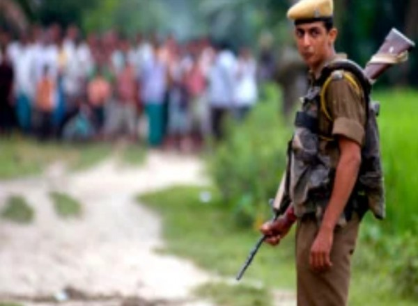 Indian photographer in video stomps on man shot by Assam police